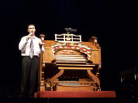 Click here to download a 2576 x 1932 JPG image of Barry Baker standing next to the 4/23 Wurlitzer at the Pasadena City College.