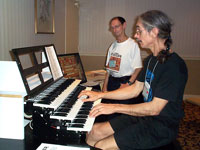 Click here to download a 1152 x 864 pixel JPG image of the Bone Doctor at the console of the Mighty MidiTzer as fellow WHOC member Russ Ashworth looks on.