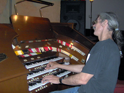 Click here to download a 2048 x 1536 JPG image showing the Bone Doctor at the console of the 3/12 Robert Morton Theatre Pipe Organ.