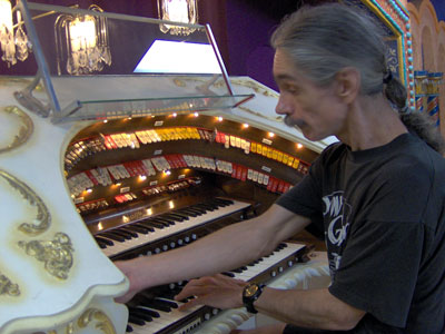 Click here to download a 2048 x 1536 JPG image showing the Bone Doctor at the console of the 3/12 Grande Page Theatre Pipe Organ.