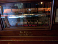 Click here to download a 2576 x 1932 JPG image of the WurliTzer Pianino that played many merry tunes as the train raced along.