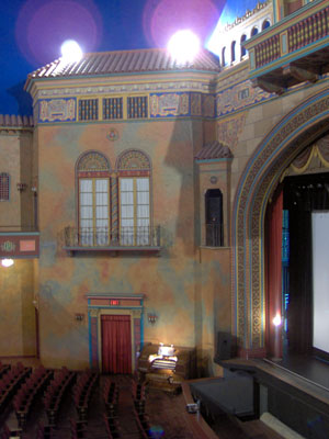 Click here to download a 1536 x 2048 JPG image showing another view of the auditorium of the Polk Theatre, looking down from the balcony.