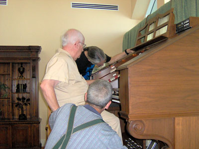 Click here to download a 2048 x 1536 JPG image of Doctor Morrell, Tom Hoehn and the Bone Doctor looking over the organ to make sure everything is go.
