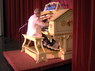 Click here to download a 2048 x 1536 JPG image showing Tom Hoehn at the console of the 3/18 Mighty WurliTzer Theatre Pipe Organ.